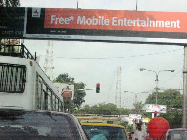 GLOW billboard at Sharae Faisal (Hotel Mehran signal)
