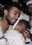 11-november-a-father-mourns-the-death-of-his-son-charsadda-Mohammad Sajjad