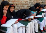 2 - February-Girls read at a school after schools reopened in Swat Valley.REUTERS-Abdul Rehman