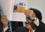 2-February-rehman-malik-shows-pictures-of-trawlers-used-in-mumbai-attacks-AP