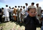6 - June-boys waits in line at an IDP camp-unknown